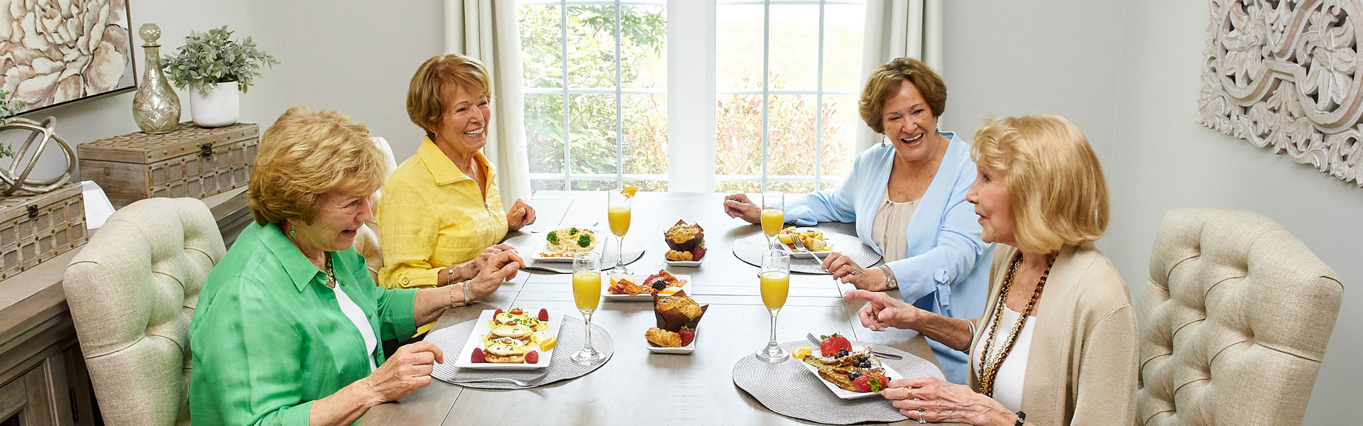 Four senior women enjoying brunch and mimosas at Friendship Village of South Hills